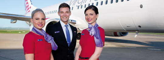 Virgin Australia crew members stood in front of Virgin Australia plane