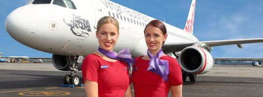 Virgin Australia crew stood in front of Virgin Australia plane