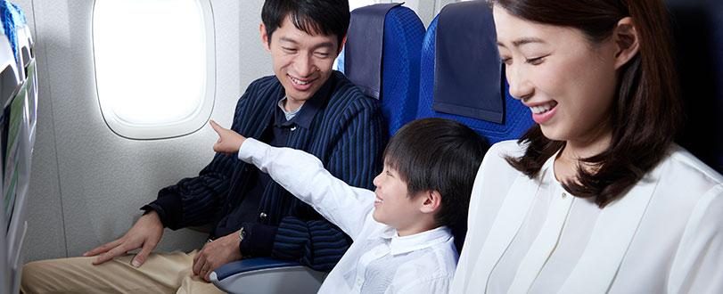 family sitting on plane